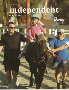Katie riding Hershey on the cover of The Independent Magazine.